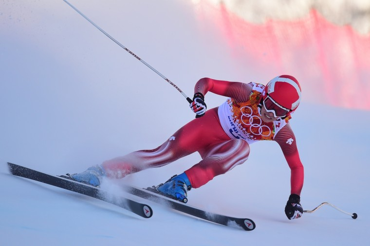 Switzerland's Dominique Gisin skis during the Women's Alpine Skiing Downhill at the Rosa Khutor Alpine Center during the Sochi Winter Olympics on February 12, 2014. (Fabrice Coffrini/AFP/Getty Images)