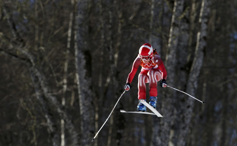 Switzerland's Dominique Gisin takes a jump during the women's alpine skiing downhill race at the 2014 Sochi Winter Olympics at the Rosa Khutor Alpine Center February 12, 2014. (REUTERS/Stefano Rellandini)