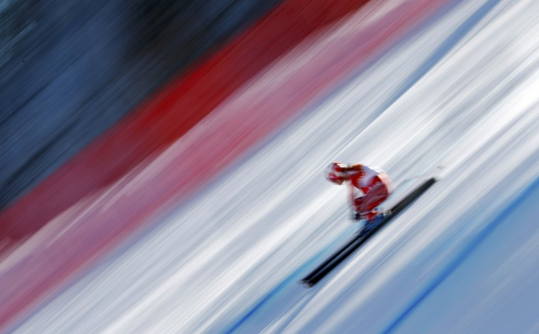 Switzerland's Dominique Gisin competes in the women's alpine skiing downhill race at the 2014 Sochi Winter Olympics February 12, 2014. (REUTERS/Dominic Ebenbichler)