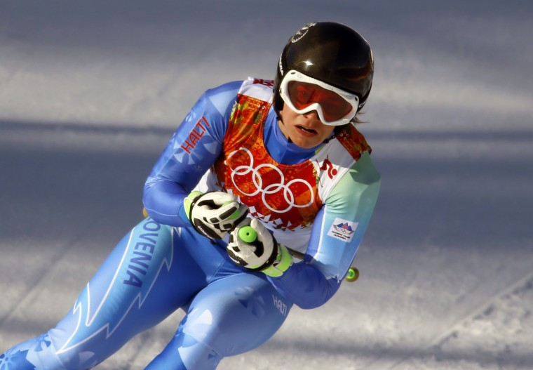 Tina Maze (SLO) competes in the ladies alpine skiing downhill during the Sochi 2014 Olympic Winter Games at Rosa Khutor Alpine Center. (Nathan Bilow-USA TODAY Sports)