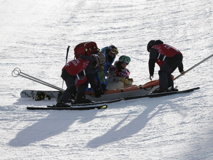 Arielle Gold (USA) is tended to after an apparent injury during practice for ladies' halfpipe qualification during the Sochi 2014 Olympic Winter Games at Rosa Khutor Extreme Park. (Andrew P. Scott-USA TODAY Sports)