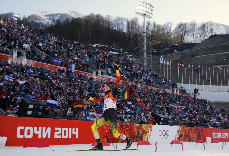 Germany's Eric Frenzel reacts after winning in the cross country race of the Nordic Combined individual normal hill 10 km event of the Sochi 2014 Winter Olympic Games, at the RusSki Gorki Ski Jumping Center in Rosa Khutor, February 12, 2014. (REUTERS/Michael Dalder)