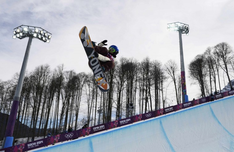 Spain's Queralt Castellet performs a jump during the women's snowboard halfpipe qualification round at the 2014 Sochi Winter Olympic Games in Rosa Khutor February 12, 2014. (REUTERS/Dylan Martinez)