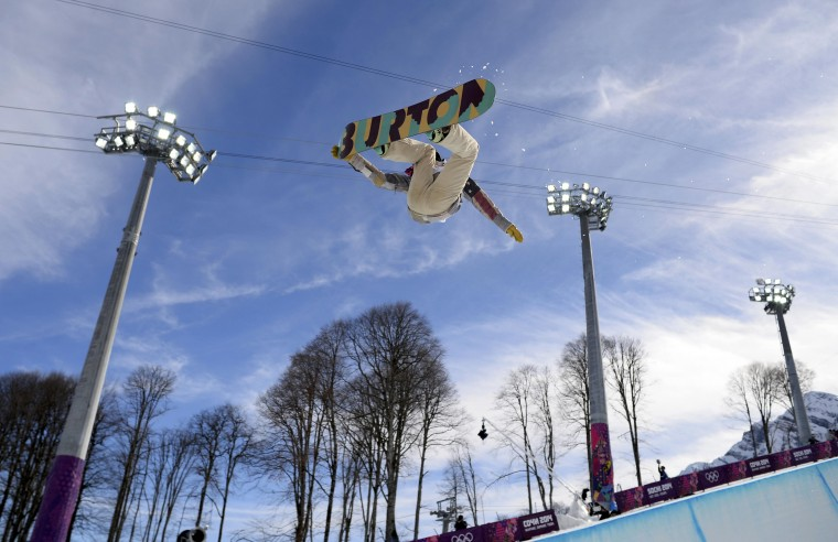 Kelly Clark of the U.S.performs a jump during the women's snowboard halfpipe qualification round at the 2014 Sochi Winter Olympic Games in Rosa Khutor February 12, 2014. (REUTERS/Dylan Martinez)