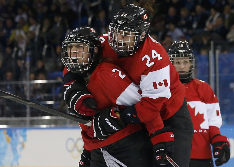 Canada's Meghan Agosta-Marciano (2) celebrates her goal with teammate Natalie Spooner (R) after scoring against Team USA during the third period of their women's ice hockey game at the Sochi 2014 Sochi Winter Olympics, February 12, 2014. (REUTERS/Jim Young)