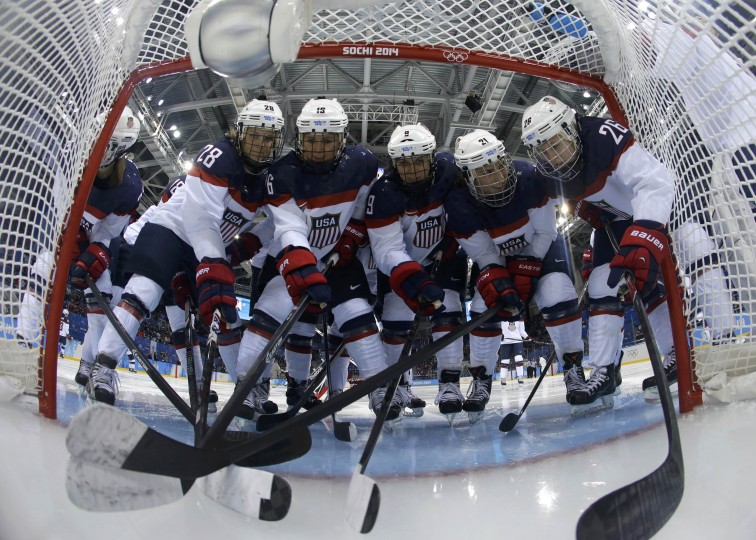 Team USA women's ice hockey players gather by the net before their game against Canada at the 2014 Sochi Winter Olympics, February 12, 2014. REUTERS/Matt Slocum