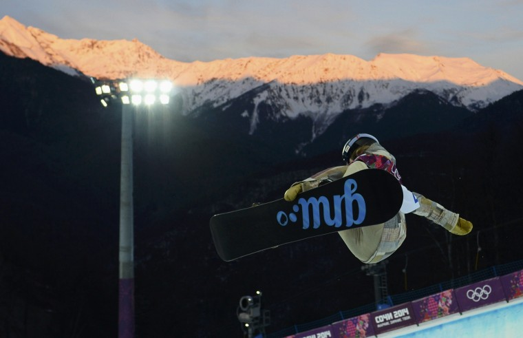 Kaitlyn Farrington of the U.S. performs a jump during a practice session for the women's snowboard halfpipe semi-finals at the 2014 Sochi Winter Olympic Games in Rosa Khutor February 12, 2014. REUTERS/Dylan Martinez