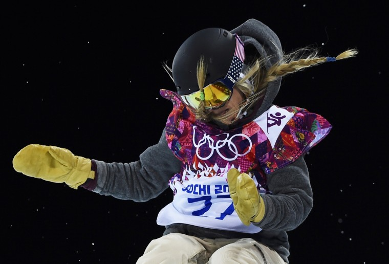 Hannah Teter of the U.S. performs a jump during the women's snowboard halfpipe finals at the 2014 Sochi Winter Olympic Games in Rosa Khutor February 12, 2014. REUTERS/Dylan Martinez