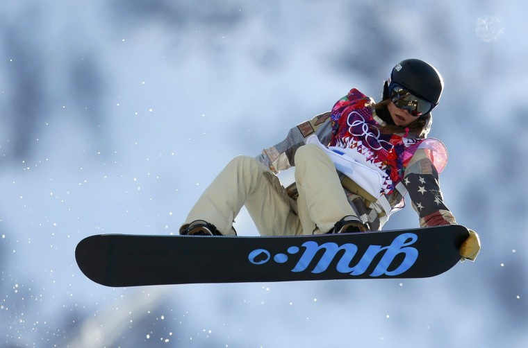 Kaitlyn Farrington of the U.S. performs a jump during the women's snowboard halfpipe qualification round at the 2014 Sochi Winter Olympic Games in Rosa Khutor February 12, 2014. REUTERS/Lucas Jackson