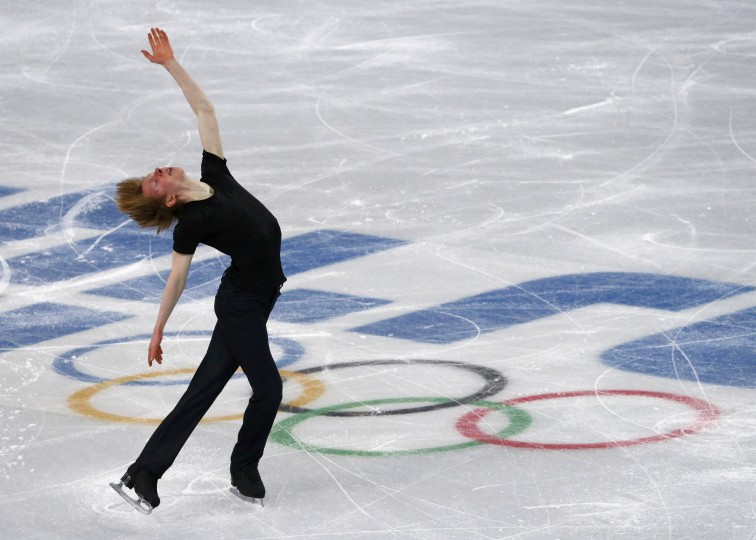 Canada's Kevin Reynolds competes during the figure skating men's short program at the Sochi 2014 Winter Olympics, February 13, 2014. REUTERS/David Gray