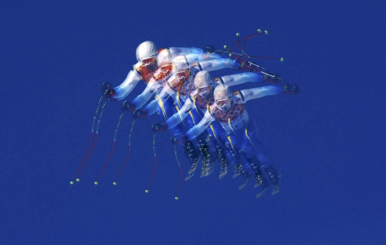 Bosnia and Herzegovina's Igor Laikert goes airborne during the downhill run of the men's alpine skiing super combined event at the 2014 Sochi Winter Olympics at the Rosa Khutor Alpine Center February 14, 2014. Picture taken with multiple exposure function. REUTERS/Stefano Rellandini