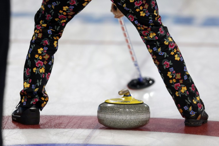 Flowery designs are seen on the pants of a member of Norway's team during their men's curling round robin game against Canada at the 2014 Sochi Winter Olympics in the Ice Cube Curling Center, February 14, 2014. REUTERS/Phil Noble