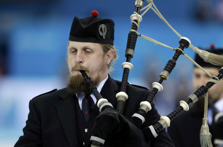 Bagpipers perfom before the start of the morning session of the men's curling round robin games at the 2014 Sochi Olympics in the Ice Cube Curling Center in Sochi, February 14, 2014. REUTERS/Phil Noble