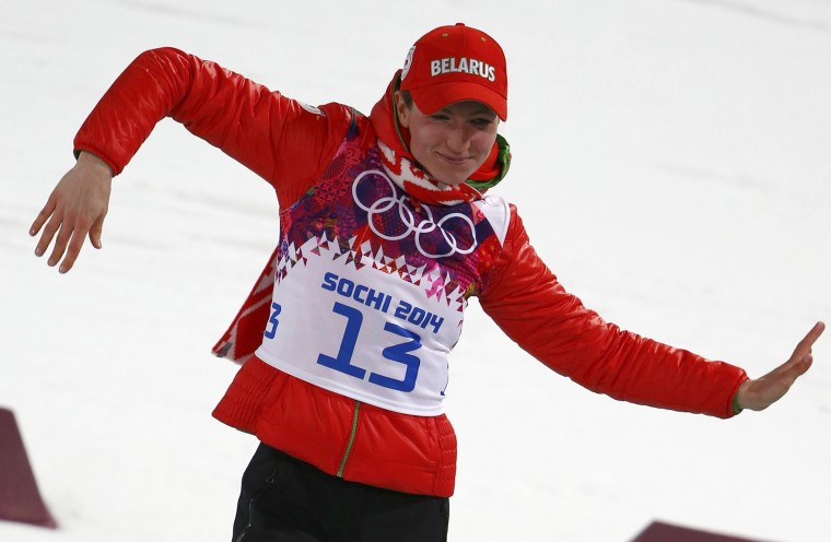 Belarus' Darya Domracheva celebrates during the flower ceremony for the women's biathlon 15km individual event at the 2014 Sochi Winter Olympics February 14, 2014. Domracheva finished first ahead of Switzerland's Selina Gasparin and compatriot Nadezhda Skardino. REUTERS/Carlos Barria