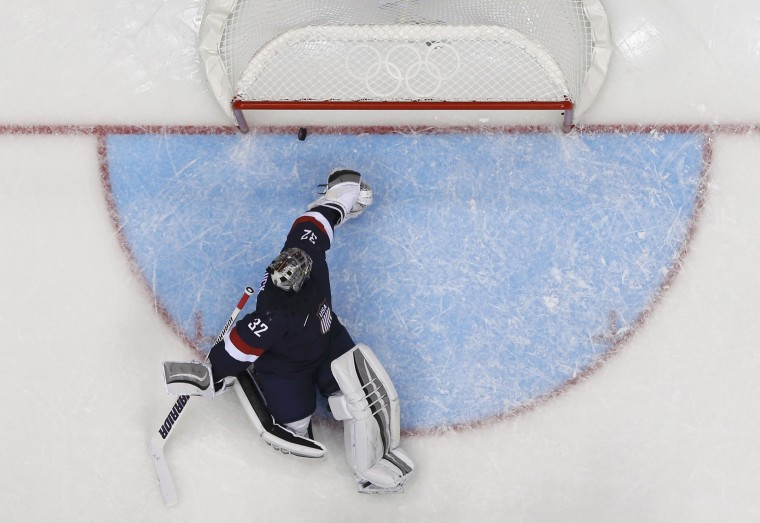 Team USA's goalie Jonathan Quick lets in a goal by Russia's Pavel Datsyuk during the second period of their men's preliminary round ice hockey game at the Sochi 2014 Winter Olympic Games February 15, 2014. REUTERS/Mark Blinch