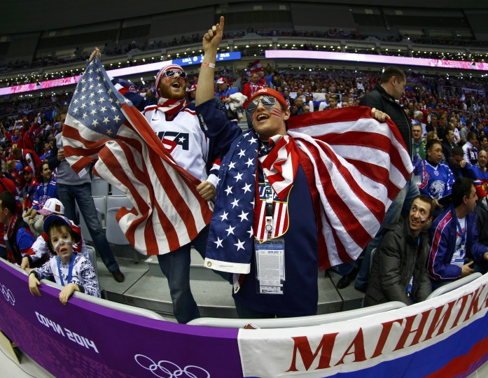 Fans of Team USA cheer before the men's preliminary round ice hockey game between Russia and Team USA at the 2014 Sochi Winter Olympics, February 15, 2014. REUTERS/Mark Blinch