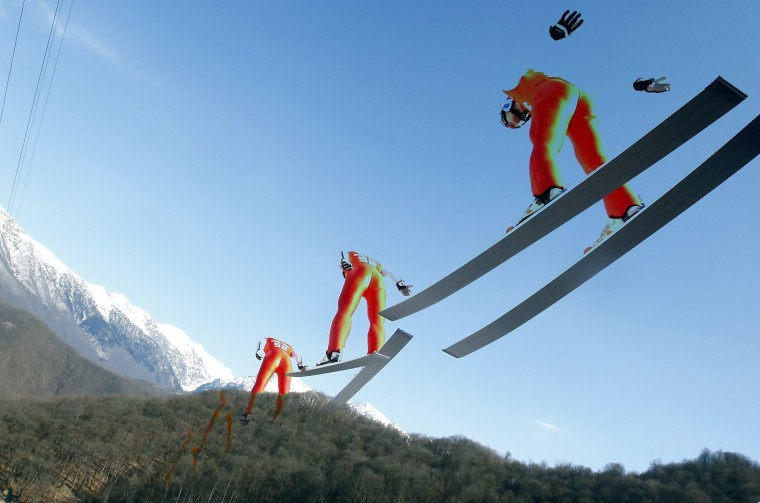 France's Jason Lamy Chappuis speeds down the jump during a training session for the large hill ski jumping portion of the Nordic combined individual 10km competition at the Sochi 2014 Winter Olympic Games, at the RusSki Gorki Ski Jumping Center in Rosa Khutor, February 15, 2014. Picture taken with multiple exposure function. REUTERS/Michael Dalder