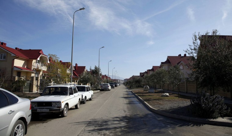 The street in front of Lyudmila Frolova's home is pictured in Sochi, February 12, 2014. Frolova, 74, was relocated three years ago from her old home near the sea to her current home further inland in order to make way for the construction of the Olympic site. She says she is happy with her new home, an upgrade from her previous one, but regrets that because of the difficulty she faces in walking, and the greater distance, she can no longer walk to the sea.