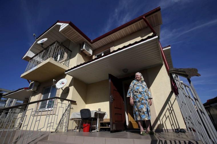 Lyudmila Frolova in front of her home in Sochi, February 12, 2014. (Eric Gaillard/REUTERS)