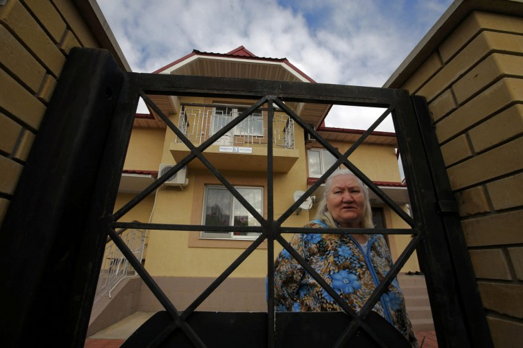 Lyudmila Frolova in front of her home in Sochi, February 12, 2014. (Eric Gaillard/REUTERS)