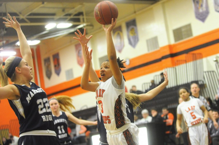 Oakland Mills's Diamond Lee puts up a shot shot as Marriotts Ridge's Jenna Kerr, left, defends on the play during a girls basketball regional playoff game at Oakland Mills High School on Wednesday, March 5. (Brian Krista/BSMG)