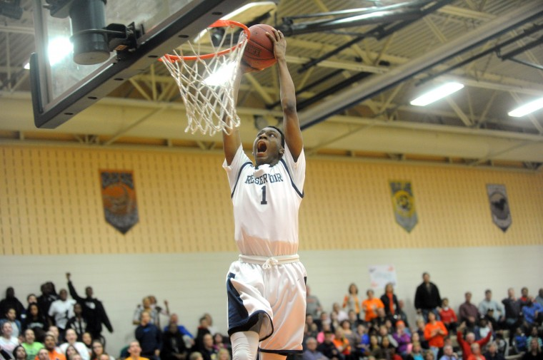 Reservoir's Aaron McDonald gets set to throw down a dunk in the waning seconds of the game to help secure victory over Glenelg during the 3A East regional boys basketball playoff game at Reservoir High School on Thursday, March 6. (Brian Krista/BSMG)
