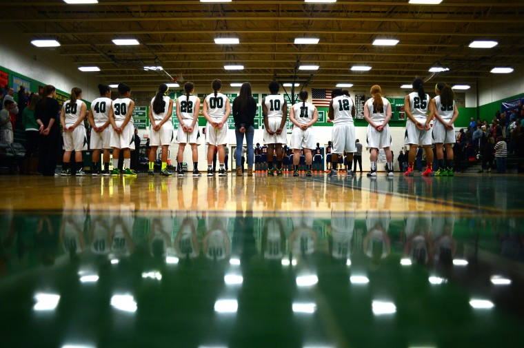 Atholton stands for the playing of the national anthem. (Matt Hazlett/BSMG)