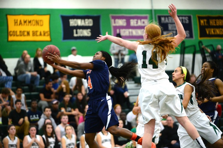 Polytechnic's Jasmine Smith, left, puts up a shot past Atholton's Sage Mayhew. (Matt Hazlett/BSMG)