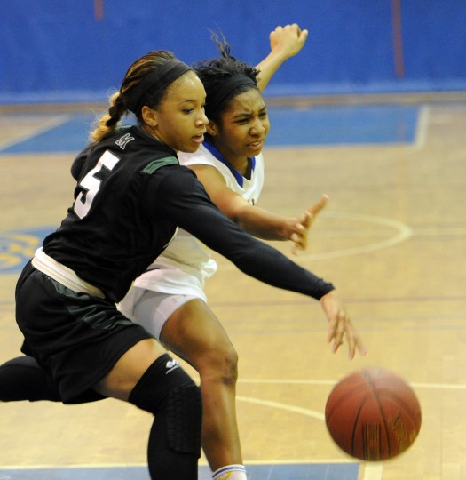 Aberdeen's Nazje Norton and Milford Mill's Kelli Smoot battle as they go for the loose ball during Saturday night's regional playoff game at Aberdeen. (Matt Button/Aegis staff)