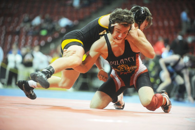 Dulaney's Jacob Asher fights to maintain a neutral position against Mt. Hebron's Connor Strunk, top, in a bout for 3rd place in the 4A/3A 152 pound weight class during the state wrestling tournament at University of Maryland's Cole Field House on Saturday, March 8. (Brian Krista/BSMG)