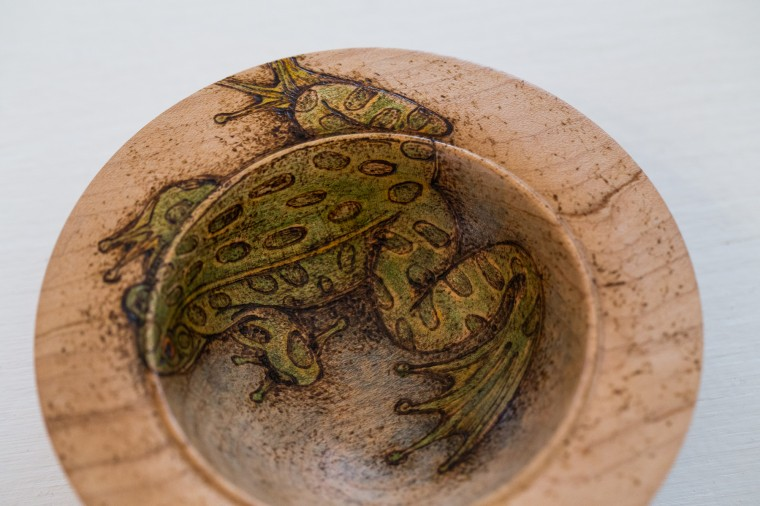"A handmade bowl titled ""Frog"" by Jeannie Rudinski-Ureno, that is made from Maple, dye, and pyrography. (Nate Pesce/BSMG Photo)"