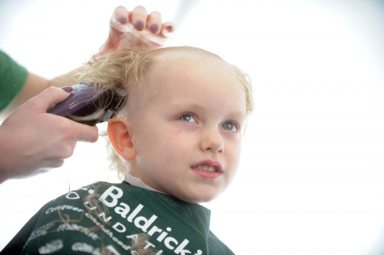 Robert Triplett of Havre de Grace has the last of his locks sheared offduring the St. Baldrick's Foundation head-shaving fundraiser at Bill Bateman's Bistro in Havre de Grace on Saturday, March 15. The St. Baldrick's Foundation is a volunteer-driven charity that funds grants for childhood cancer research. (Brian Krista/BSMG)