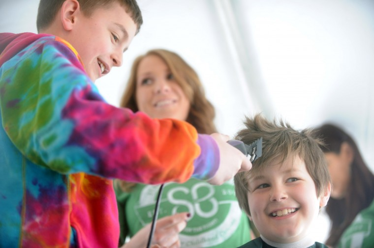 Thomas Saacks, 10, of Havre de Grace, who's currently in remission from liver cancer, gets ready to make the first cuts into his friend's hair, Evan Hurst, 9, of Havre de Grace, who wanted to show support for his friend by getting his head shaved during the St. Baldrick's Foundation fundraiser at Bill Bateman's Bistro in Havre de Grace on Saturday, March 15. The St. Baldrick's Foundation is a volunteer-driven charity that funds grants for childhood cancer research. (Brian Krista/BSMG)