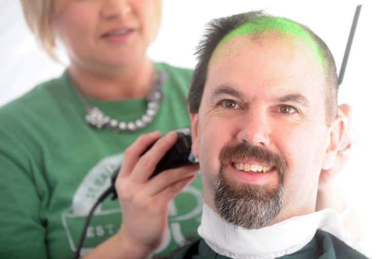 Christian Giansante, owner of Bill Bateman's Bistro, is seen with half his head shaved during the St. Baldrick's Foundation head-shaving fundraiser at Bill Bateman's Bistro in Havre de Grace on Saturday, March 15. (Brian Krista/BSMG)