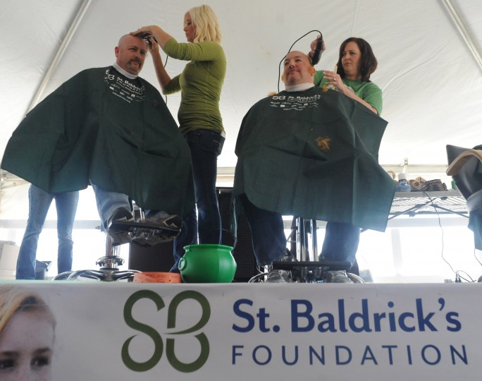 Susquehanna Hose Company members Chief Scott Hurst, left, and Billy Berg, also the event organizer, have their heads shaved by stylist Amanda Scott and Jennifer Old, respectively during the St. Baldrick's Foundation fundraiser at Bill Bateman's Bistro in Havre de Grace on Saturday, March 15. (Brian Krista/BSMG)