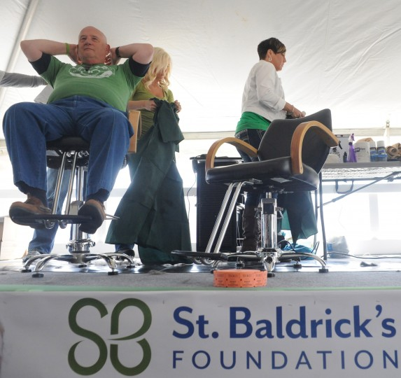 Charlie Packard, president of the Susquehanna Hose Company, feels the back of head after having his head shaved during the St. Baldrick's Foundation head-shaving fundraiser at Bill Bateman's Bistro in Havre de Grace on Saturday, March 15. The St. Baldrick's Foundation is a volunteer-driven charity that funds grants for childhood cancer research. (Brian Krista/BSMG)