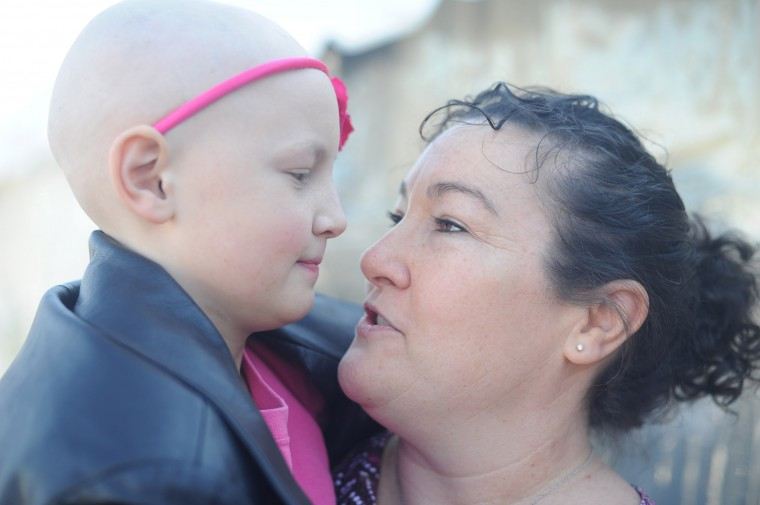 Becky Whitt of Delta, Pa., talks with her daughter Serena, 9, who is currently battling and undergoing treatment for neuroblastoma during the St. Baldrick's Foundation head-shaving fundraiser at Bill Bateman's Bistro in Havre de Grace on Saturday, March 15. (Brian Krista/BSMG)