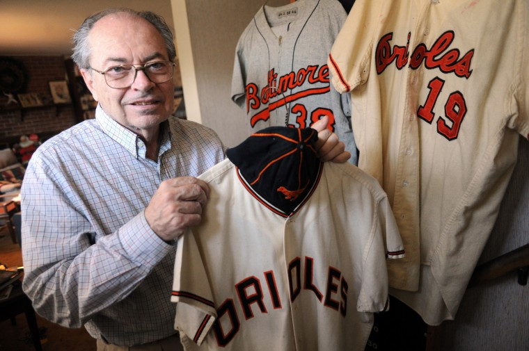 Ted Patterson, an Orioles/baseball memorabilia collector, displays several of his jerseys at his home in Towson on Friday, March 21. The jerseys include 1964 Steve Barber, 1964 Robin Roberts and 1966 Dave McNally. (Brian Krista/BSMG)