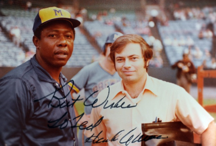 Ted Patterson, right, baseball memorabilia collector, is seen in an autographed photograph with Hank Aaron. (Brian Krista/BSMG)