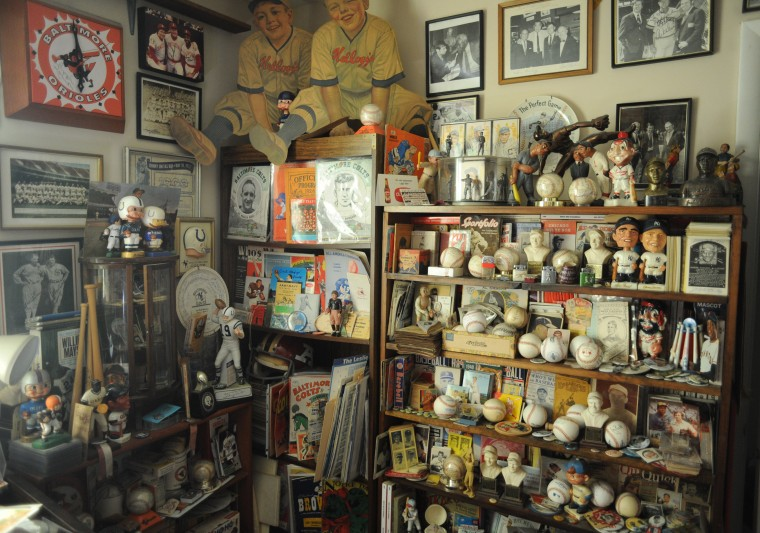 Walls and shelves are filled with baseball memorabilia at the home of Towson resident Ted Patterson. (Brian Krista/BSMG)