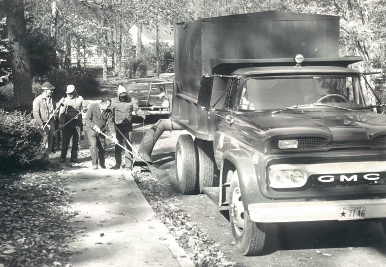 Sanitation crews in Baltimore County are using a vacuum device to sweep leaves of streets. (Baltimore Sun file/Oct. 26, 1960)