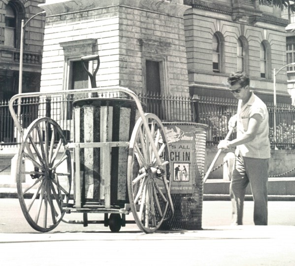 A street sweeper plies his trade at the Battle Monument. (Clarence B. Garrett/Baltimore Sun/June 8, 1965)