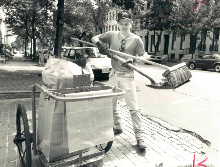 Hokey man Robert Welling sweeps up the trash on May 23, 1991. (Perry Thorsvik/Baltimore Sun file)