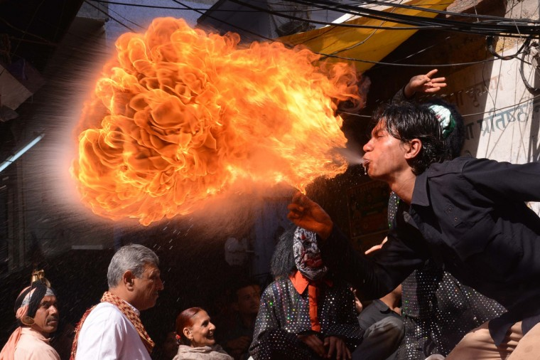 An Indian Hindu devotee performs with fire as he participates in a procession ahead of the Holi festival in Amritsar. Holi, the popular Hindu spring festival of colors is observed in India at the end of the winter season on the last full moon of the lunar month. It will be celebrated on March 16 this year (Narinder Nanu/Getty Images)