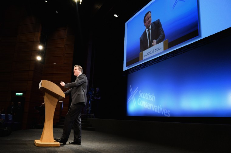 """British Prime Minister David Cameron gives his speech to the Scottish Conservative party conference on March 14, in Edinburgh, Scotland. The prime minister opened his party's Scottish conference by warning delegates that a yes vote in Scotland's September independence referendum would tear apart the existing UK family of """"nations."""" (Photo by Jeff J Mitchell/Getty Images)"""