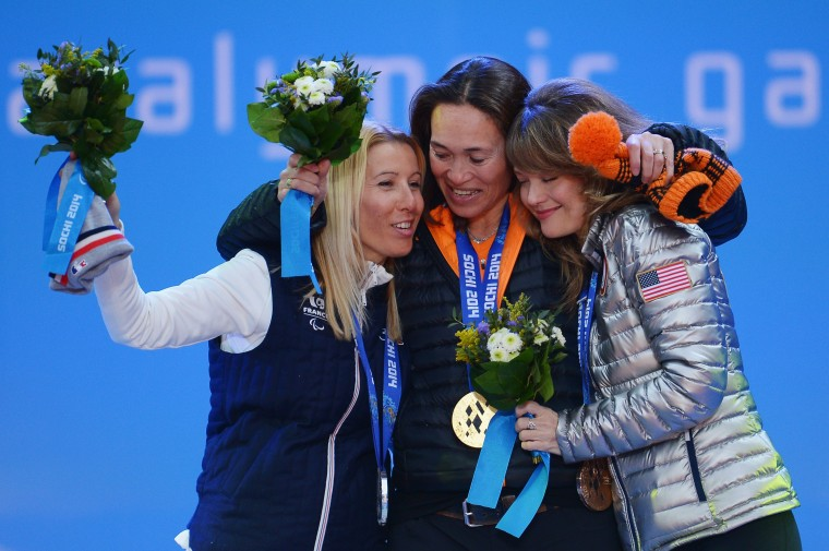 Silver medalist Cecile Hernandez Cervellon of France, gold medalist Bibian Mentel-Spee of Netherlands and bronze medalist Amy Purdy of the United States celebrate during the medal ceremony for Women's Snowboard Cross Standing on day seven of the Sochi 2014 Paralympic Winter Games on March 14, 2014 in Sochi, Russia. (Photo by Dennis Grombkowski/Getty Images)