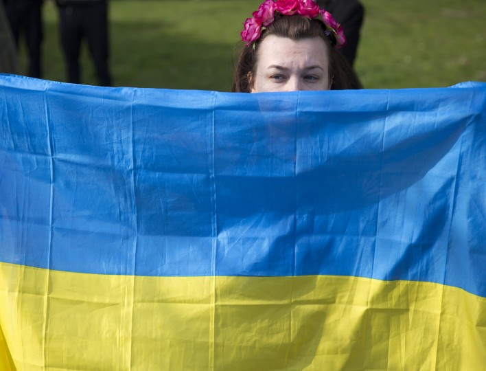 A protester holds a Ukrainian flag outside Winfield House, the residence of the US Ambassador to the UK, where talks are taking place between US Secretary of State John Kerry and his Russian counterpart, Sergei Lavrov on March 14, 2014 in London, England. Mr Kerry has met with his Russian counterpart Sergei Lavrov to discuss the Ukrainian crisis situation in London ahead of a disputed referendum in Crimea on Sunday. (Photo by Oli Scarff/Getty Images)