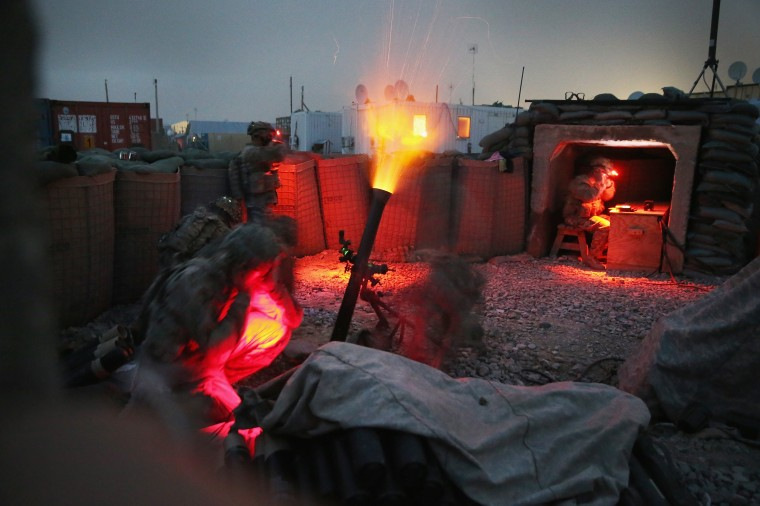 Soldiers with the U.S. Army's 3rd Brigade Combat Team, 10th Mountain Division, fire a mortar round during a training exercise on FOB Lightning near Gardez, Afghanistan. The mission of the brigade is to advise and assist the Afghan National Army on nearby FOB Thunder. Most U.S. troops no longer undertake combat roles in Afghanistan. (Scott Olson/Getty Images)