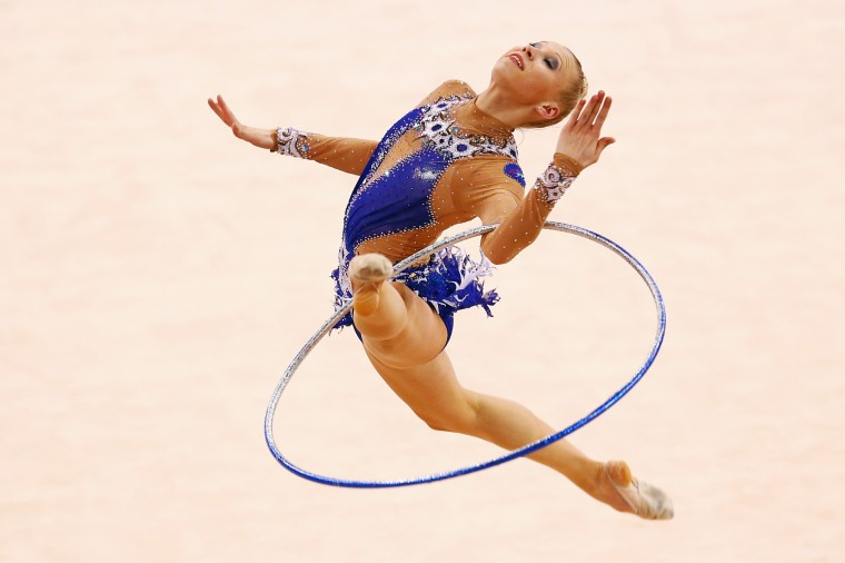 Kseniya Moustafaeva of France performs with the hoop during individual competition of the GAZPROM World Cup Rhythmic Gymnastics at Porsche Arena in Stuttgart, Germany. (Alex Grimm/Bongarts/Getty Images)