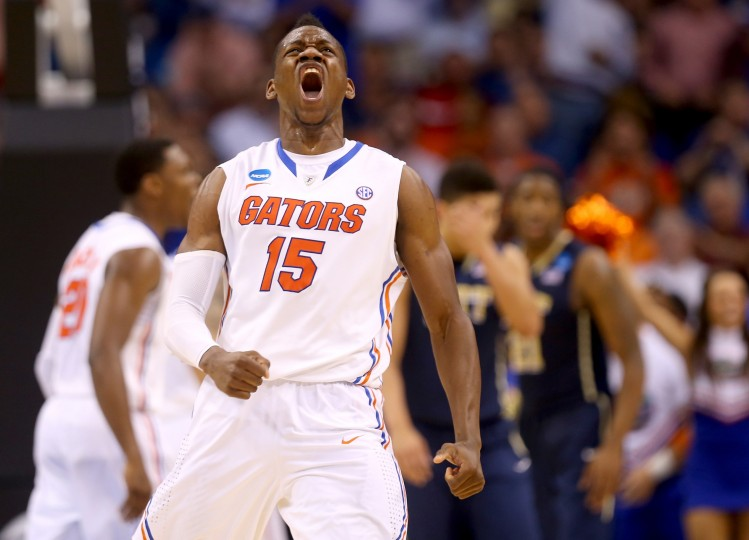 Florida Gators forward Will Yeguete (15) of the reacts in the second half while taking on the Pittsburgh Panthers during the third round of the 2014 NCAA Men's Basketball Tournament at Amway Center in Orlando, Florida. (Mike Ehrmann/Getty Images)